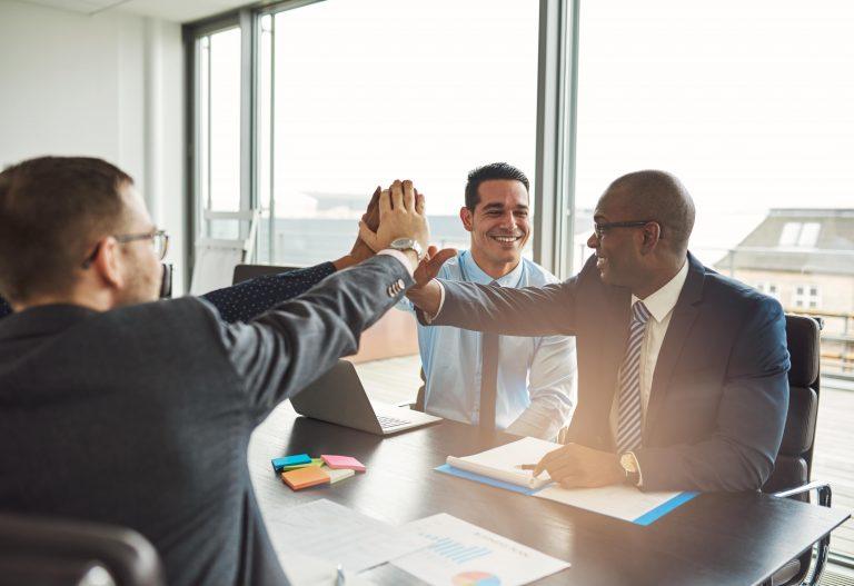 Successful business men celebrating