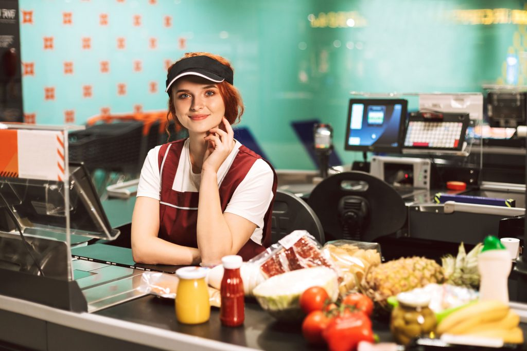 Smiling young woman over the counter